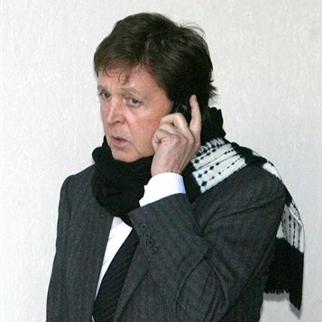 paul_mccartney_is_shown_using_his_mobile_phone_in__4e3b0f98ce
